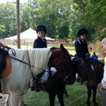 Alex, Alexis, and Vicki on their mounts, getting a pre-ride brief from their instructor (Anna)